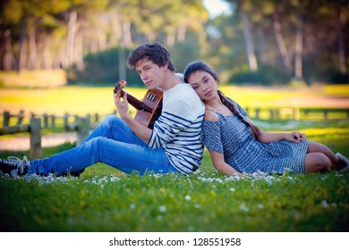 romantic couple in love playing guitar