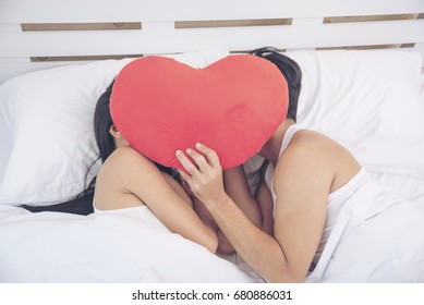 Romantic Couple lover look at other focus on beautiful woman on bed. woman smiling to boyfriend. Lover Concept.