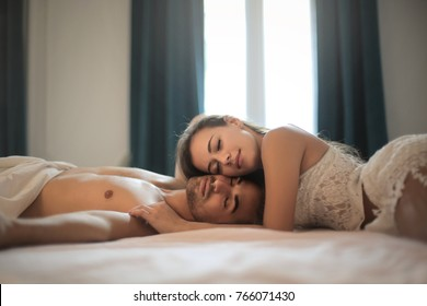 Romantic couple lying on their bed