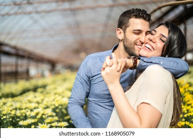 Romantic Couple on a Love Moment at Greenhouse in Holambra, Sao Paulo, Brazil