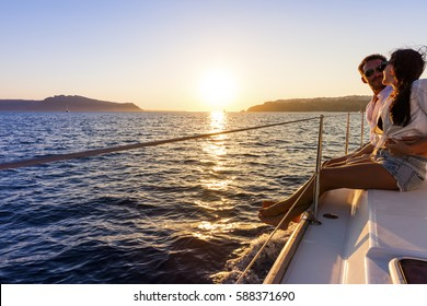 Romantic couple on yacht at sunset
