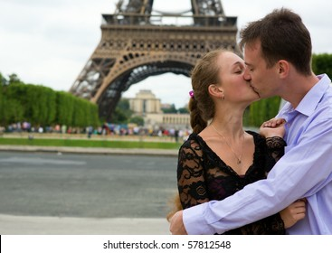 Romantic couple in Paris near the Eiffel Tower