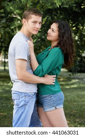 Romantic couple posing in city park, summer season, lovers boy and girl