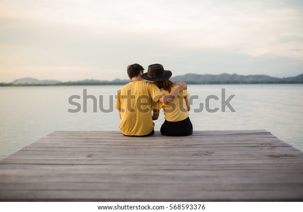 Romantic couple relaxing on the dock