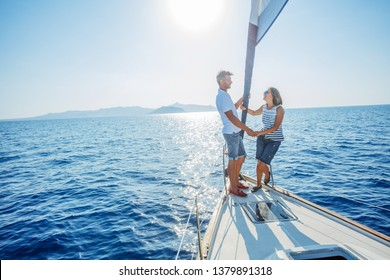 Romantic couple relaxing on yacht in Greece. Luxury yacht and cruise holiday.