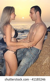 Romantic couple at seaside on a sunset