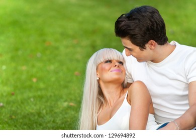 Romantic couple sharing quality time in park.