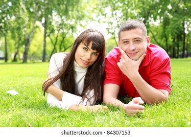 Romantic couple spending time together in the summer park