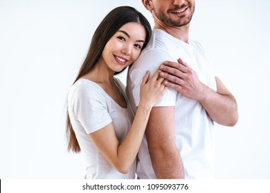 The romantic couple standing on the white background