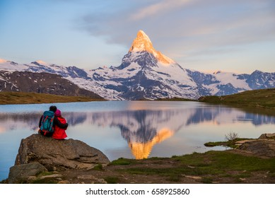 Romantic couple at sunrise, from lake Stellisee, Swiss Alps , Matterhorn Peak, Zermatt,