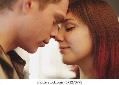 Romantic couple touching and kissing each other