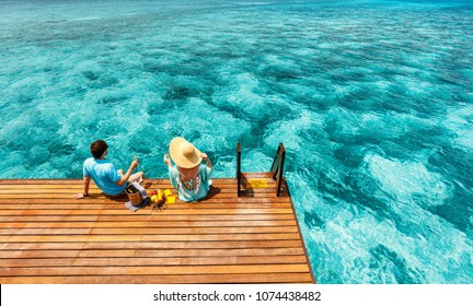 Romantic couple at tropical resort during honeymoon vacation - Shutterstock ID 1074438482