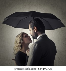 romantic couple with umbrella