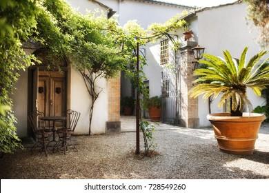 Romantic courtyard in the Italian villa.