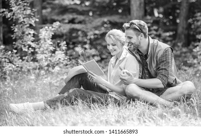 Romantic date at green meadow. Couple in love spend leisure reading book. Romantic couple students enjoy leisure with poetry nature background. Couple soulmates at romantic date. Pleasant weekend.