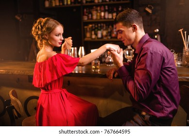 Romantic date in restaurant, woman flirts with man