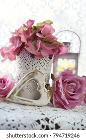 romantic decoration with hearts,roses and lanterns in shabby chic style for wedding or valentine`s day