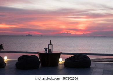 Romantic dining table on terrace in the sunset moment