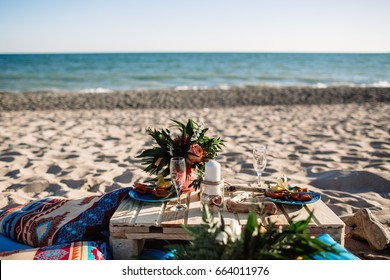 Romantic dinner, candles at ocean beach. Honeymoon, proposal or wedding background concept.