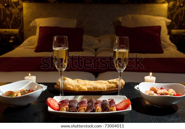 romantic dinner with champagne in the bedroom