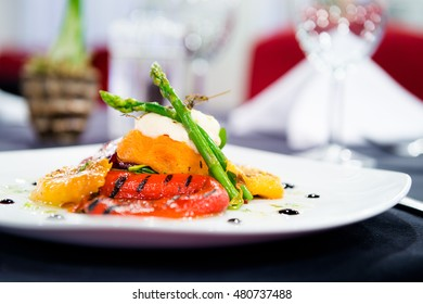 Romantic dinner - A delicious plate of fresh food in a stylish restaurant