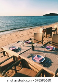 Romantic dinner on the beach. Old fashion retro styled photo