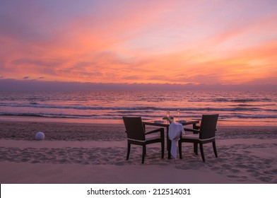 romantic dinner on the beach with sunset