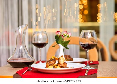 Romantic dinner at restaurant with wine