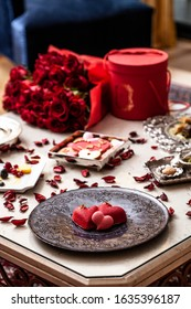 Romantic dinner setup, red decoration with candle light in a restaurant. Valentine's day decor
