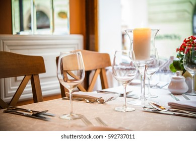 Romantic Dinner Table with Burning Candle Closeup Photo.