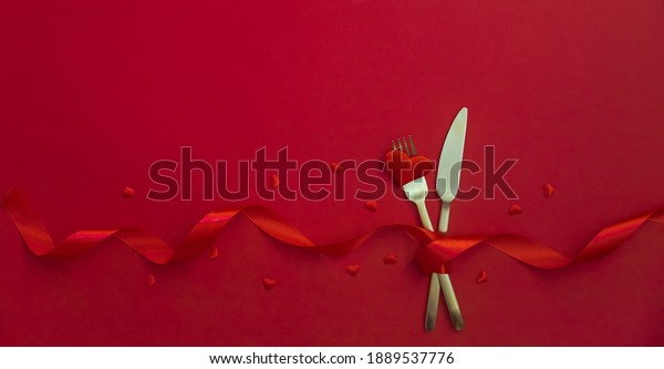 Romantic dinner for Valentine's day on a red background. Selective focus. Holiday.