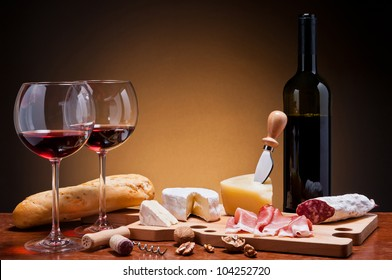 romantic dinner with wine, cheese and traditional sausages