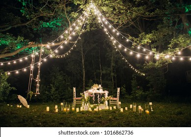 romantic dinner in the woods by candlelight
