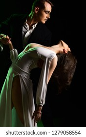 The romantic drama. Couple in love with mime makeup. Couple of mime artists perform romance on stage. Theatre actors miming through body motions. Mime man and woman act in romantic scene.