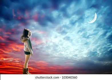 Romantic dreaming girl look at the moon