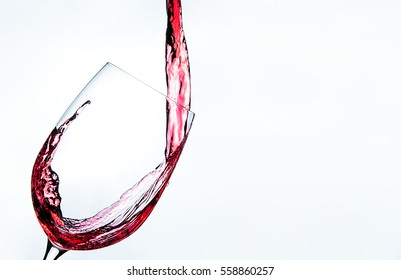 Romantic drink red wine on the glass on white background with splash