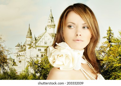 Romantic escape, beautiful young woman and fairytale castle