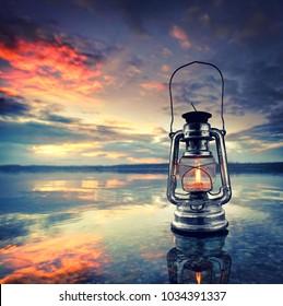romantic evening at the beach, vintage lantern at sunset