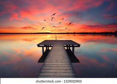 romantic evening at the beach - wooden jetty at sunset
