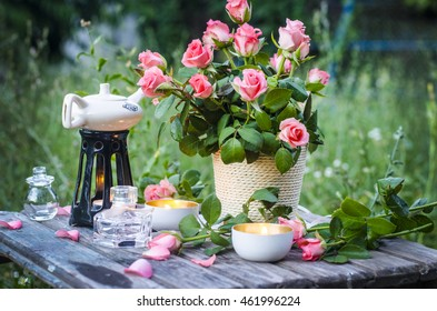 Romantic evening. Bunch of pink roses on a wooden table.