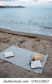 Romantic evening near the sea. Sheet with pillow on the sandy beach
