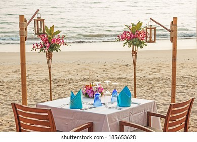 Romantic evening table for two persons on the beach. Canon 5D Mk II.