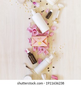 Romantic festive still life with cosmetics bottles, accessories, a gift box and rose petals on white background. Valentine's Day. Festive bath time for her. Home spa for girlfriend. Top view