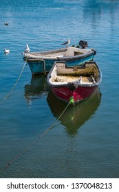 Romantic fishing boats in a harbor in southern England