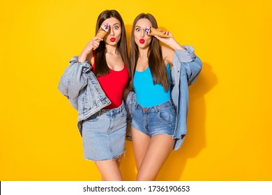 Romantic flirty sisters girls have fun close cover face with tasty yummy icrecream send air kiss their boyfriends wear denim blue red singlet isolated bright shine color background