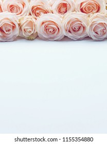 Romantic floral frame background.Pink roses on white background.