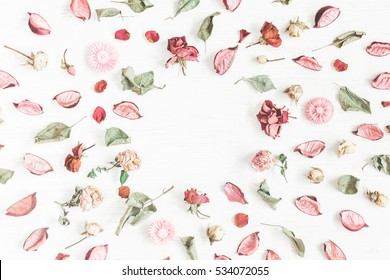 Romantic flowers. Frame made of dried flowers and leaves. Top view, flat lay.