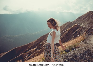 Romantic free young woman with hair wind enjoy harmony with nature and fresh air. Peace of mind. Happy tranquil girl, inspiration background. Mountain landscape. Life balance. Mindfulness concept.