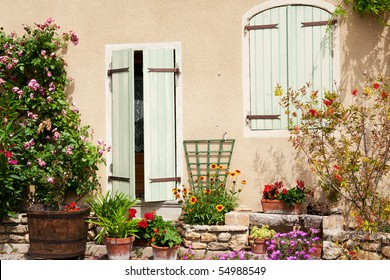 Romantic French house with blinds and flowers
