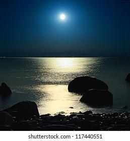 A romantic full moon rise at Assos, Turkey